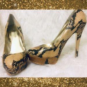Bebe leather snake skin high heel pumps size 6